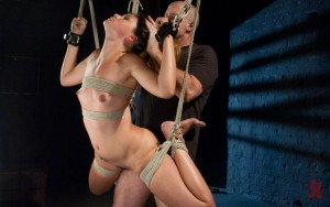 Bound and suspended girl has her pussy fucked while being pulled by the hair