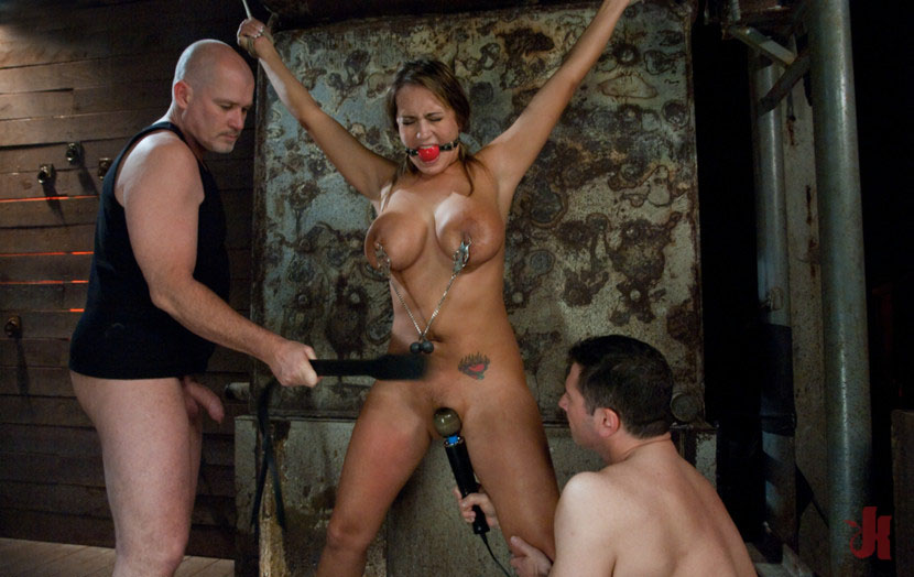 Busty slave is gagged and whipped while getting teased with a toy