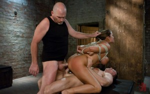 Tied up brunette has her hair pulled while doing a double penetration
