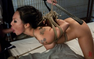 Asian masseuse is throat-fucked and tied up in rope while having her ass spanked