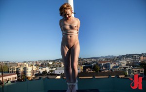 Kinky blonde is stripped, gagged and tied to a pole in a public place before getting fucked