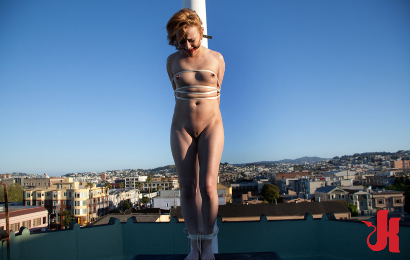 nude penus tied to pole