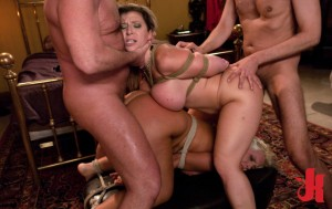 Two plump, tied up and submissive blondes are fucked hard from behind by two dominating men