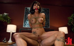 Kinky, submissive brunette is tied up and gagged and forced to ride a thick dick in her ass